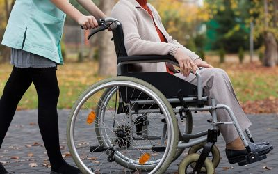 Lady on wheelchair and nurse from the outside