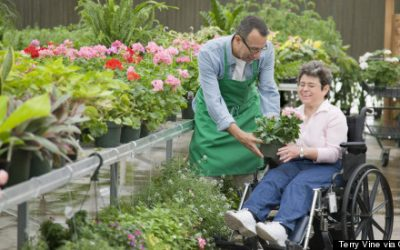 Florist helping customer seated in wheelchair